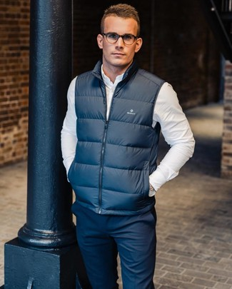 How to wear: navy chinos, white long sleeve shirt, navy gilet