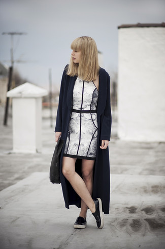 A navy blue coat and a monochrome floral bodycon dress are a great outfit formula to have in your arsenal. Rock a pair of black leather slip-on sneakers for a more relaxed feel.
