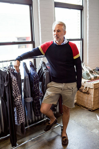 How to wear: navy crew-neck sweater, light blue long sleeve shirt, beige shorts, dark brown suede driving shoes