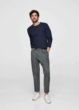 How to wear: navy crew-neck sweater, white crew-neck t-shirt, grey vertical striped dress pants, white leather low top sneakers