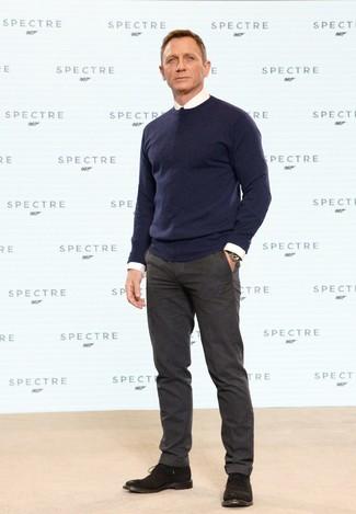 Daniel Craig wearing Navy Crew-neck Sweater, White Dress Shirt, Dark Brown Wool Dress Pants, Dark Brown Suede Desert Boots