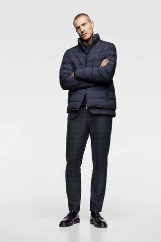 How to wear: black leather derby shoes, navy crew-neck t-shirt, black wool suit, navy puffer jacket
