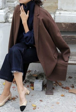 How to wear: black and tan leather pumps, navy denim culottes, navy knit turtleneck, brown coat