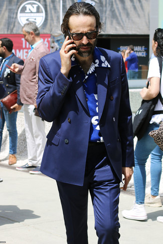 How to wear: dark brown sunglasses, navy dress pants, blue print short sleeve shirt, navy double breasted blazer