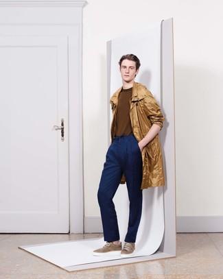 How to wear: brown low top sneakers, navy dress pants, brown crew-neck sweater, tan raincoat