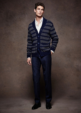 Men's Looks & Outfits: What To Wear In 2020: Go all out in a navy fair isle shawl cardigan and navy dress pants. Now all you need is a good pair of black leather derby shoes to complement your outfit.