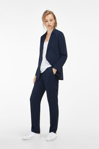 How to wear: white leather low top sneakers, navy dress pants, white silk tank, navy blazer