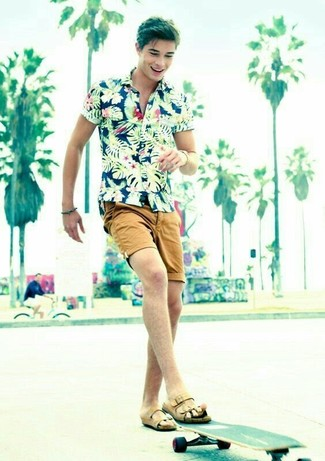 How to wear: navy floral short sleeve shirt, tan shorts, tan leather sandals