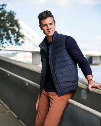 How to wear: navy gilet, navy crew-neck sweater, orange jeans