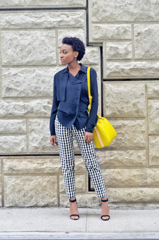 How to wear: yellow leather satchel bag, navy leather heeled sandals, white and black gingham dress pants, navy button down blouse