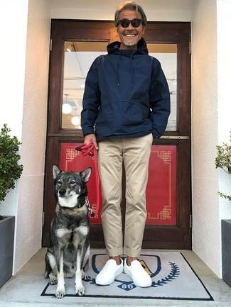 How to wear: navy hoodie, beige chinos, white slip-on sneakers, black sunglasses