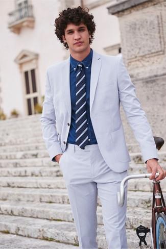 How to wear: navy horizontal striped tie, navy denim shirt, light blue seersucker suit