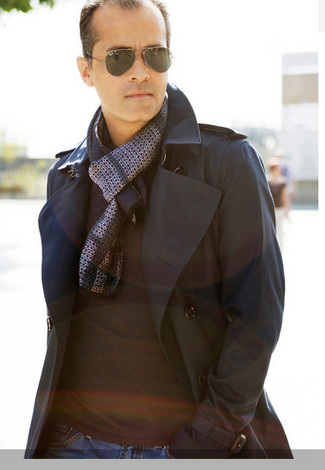How to wear: grey scarf, navy jeans, black crew-neck sweater, black trenchcoat