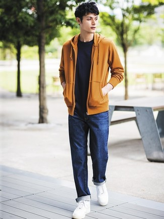 How to wear: white leather low top sneakers, navy jeans, black crew-neck t-shirt, mustard hoodie