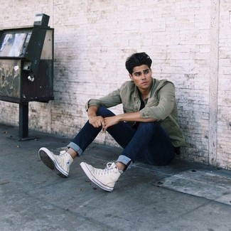 Men's Looks & Outfits: What To Wear In 2020: An olive shirt jacket and navy jeans have become bona fide wardrobe items for most guys. Finishing with white canvas high top sneakers is a fail-safe way to introduce a touch of stylish effortlessness to this look.