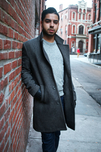 How to wear: black leather gloves, navy jeans, grey crew-neck sweater, charcoal overcoat
