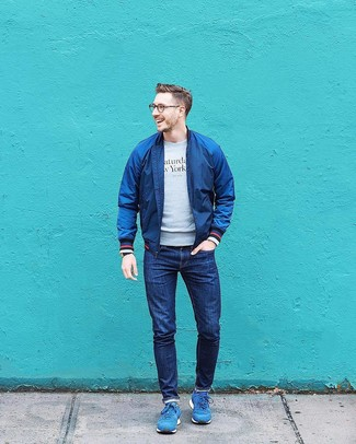 How to wear: blue athletic shoes, navy jeans, grey print sweatshirt, navy bomber jacket