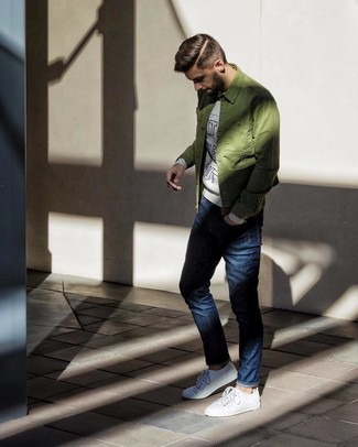 How to wear: white low top sneakers, navy jeans, grey print sweatshirt, olive shirt jacket