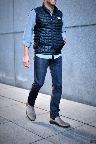 How to wear: grey suede chelsea boots, navy jeans, light blue denim shirt, navy quilted gilet
