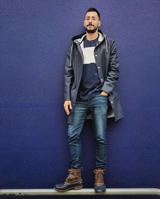 How to wear: brown snow boots, navy jeans, navy and white crew-neck sweater, navy raincoat