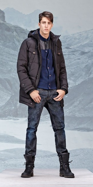How to wear: black leather work boots, navy jeans, navy wool bomber jacket, black parka