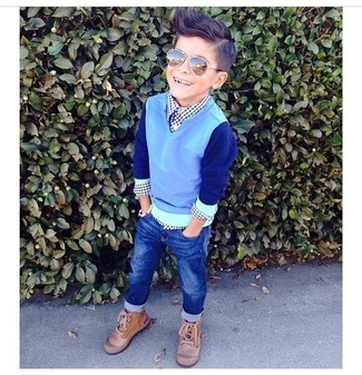 How to Wear a Light Blue Sweater For Boys: Suggest that your kid wear a light blue sweater and navy jeans for a comfy outfit. Complement this look with tan boots.