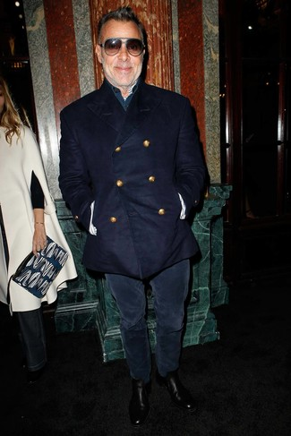 How to wear: black leather chelsea boots, navy corduroy jeans, navy long sleeve shirt, navy pea coat