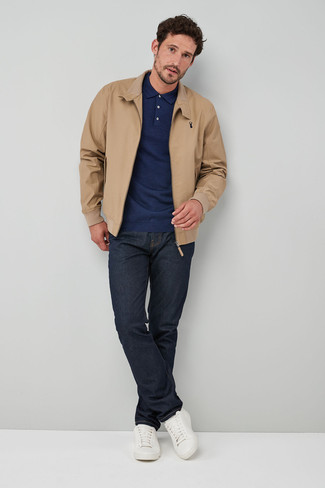 How to wear: white leather low top sneakers, navy jeans, navy polo neck sweater, tan harrington jacket