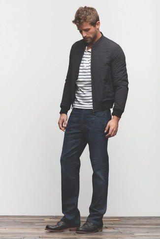 How to wear: black leather desert boots, navy jeans, white and navy horizontal striped henley shirt, black bomber jacket