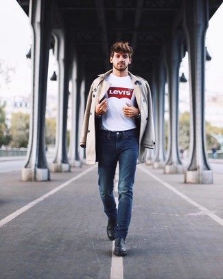 How to wear: black leather chelsea boots, navy jeans, white and red print crew-neck t-shirt, beige trenchcoat