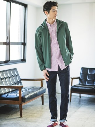 How to wear: burgundy canvas low top sneakers, navy jeans, white and red vertical striped short sleeve shirt, dark green windbreaker