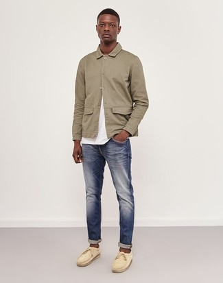How to wear: beige suede boat shoes, navy jeans, white crew-neck t-shirt, beige shirt jacket