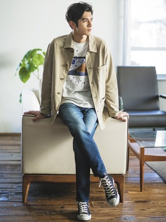 How to wear: navy canvas high top sneakers, navy jeans, white print crew-neck t-shirt, beige shirt jacket