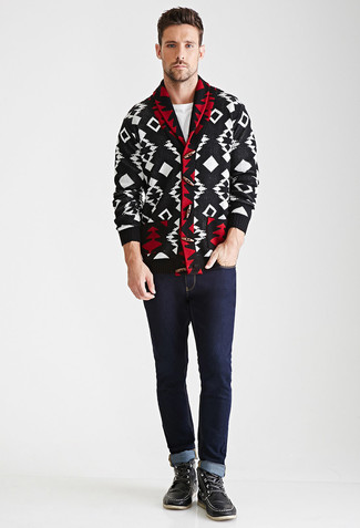 How to wear: black leather work boots, navy jeans, white crew-neck t-shirt, black and white geometric shawl cardigan