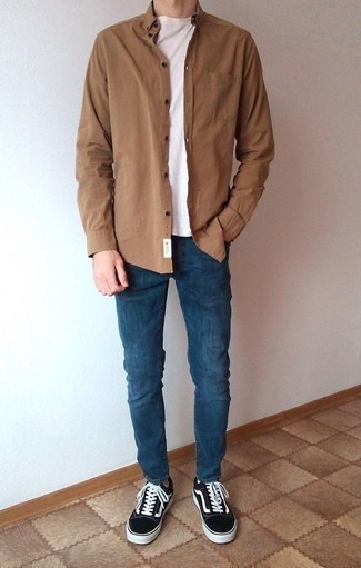 How to Wear a Brown Long Sleeve Shirt For Men: Why not wear a brown long sleeve shirt with navy jeans? These two items are super practical and will look cool when married together. Add a pair of black and white canvas low top sneakers and the whole getup will come together.