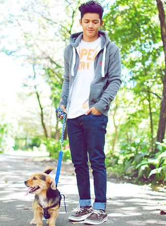 How to wear: dark brown leather boat shoes, navy jeans, white print crew-neck t-shirt, grey hoodie