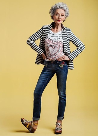 Women's Looks & Outfits: What To Wear In 2020: A white and black horizontal striped blazer and navy embroidered jeans are the kind of a tested off-duty outfit that you so awfully need when you have no time to dress up. We're totally digging how a pair of grey snake leather wedge sandals makes this outfit whole.