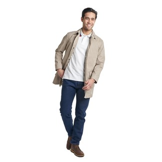How to wear: dark brown leather desert boots, navy jeans, white polo, beige trenchcoat