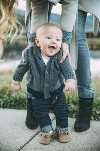 How to Wear Brown Boots For Boys: Suggest that your little guy wear a charcoal cardigan and navy jeans for a dapper casual get-up. Brown boots are a wonderful choice to finish off this look.