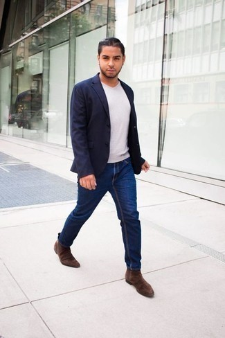 How to Wear a White V-neck T-shirt For Men: Swing into something laid-back yet current with a white v-neck t-shirt and navy jeans. Our favorite of a variety of ways to finish off this outfit is with a pair of brown suede chelsea boots.