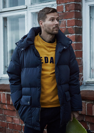 How to wear: navy jeans, yellow print sweatshirt, navy puffer coat