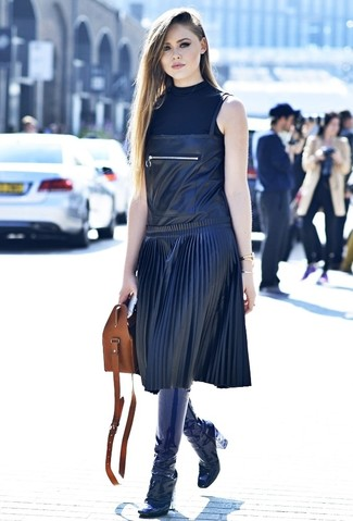 How to wear: brown leather tote bag, navy leather knee high boots, black leather overall dress, black sleeveless turtleneck