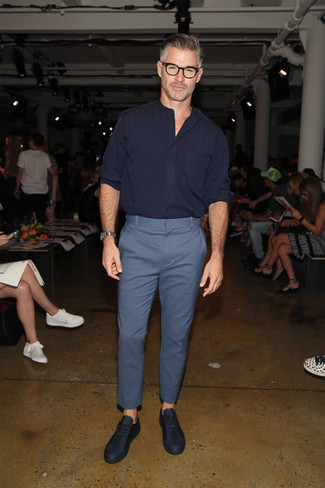 Fashion for Men Over 50: What To Wear: To achieve a casual ensemble with a contemporary spin, rock a navy long sleeve shirt with blue chinos. Dress down this getup by finishing with navy leather low top sneakers.
