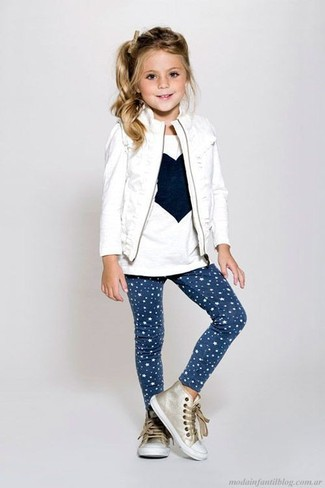 How to wear: gold sneakers, navy star print leggings, white print long sleeve t-shirt, white gilet