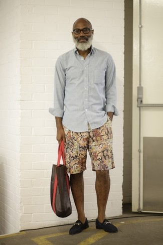 How to wear: dark brown leather tote bag, navy suede loafers, multi colored print shorts, grey long sleeve shirt
