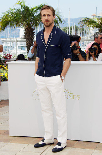 Ryan Gosling wearing Navy Long Sleeve Shirt, White Dress Pants, White and Black Leather Oxford Shoes, Brown Leather Watch