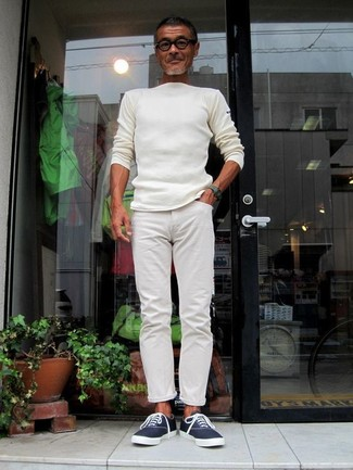 How to wear: dark green watch, navy canvas low top sneakers, white chinos, white crew-neck sweater