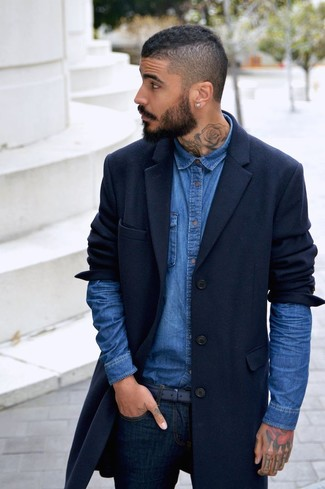 How to wear: navy overcoat, blue denim shirt, navy skinny jeans, navy leather belt