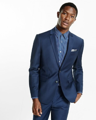 Men's Looks & Outfits: What To Wear In 2020: For manly elegance with a modern spin, team a navy suit with a navy and white polka dot dress shirt.