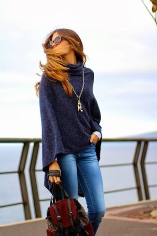 If you like the comfort look, consider pairing a navy poncho with a backpack. When temps are getting lower and fall is setting in, you'll love this combo as your favorite for weird transition weather.